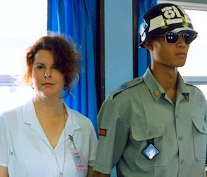 Producer Marsha Roberts next to a ROK soldier on the line separating N. & S. Korea